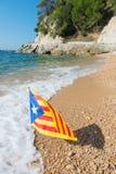 Catalan flag at beach Royalty Free Stock Image
