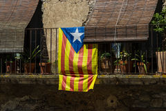 The Catalan flag. Catalonia flag hung on the balcony of the building stock photo