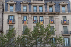 Catalan flag Estelada hanging from balconies in Barcelona, Spain. Royalty Free Stock Photos
