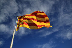 Catalan flag fluttering in the wind Stock Images