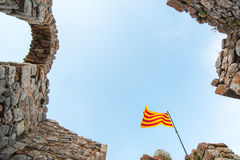 Catalan flag flying. A catalan flag on a ruined stone castle Stock Photos