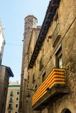 Catalan flag, hanging on a balcony, in the Gothic Quarter of Bar Stock Images
