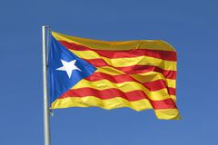 Catalan flag independence separatist flag waving in blue sky Stock Photo