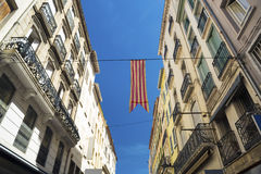 Catalan flag in Perpignan. Catalan flag over a street in Perpignan Royalty Free Stock Photography