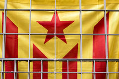 Catalan flag (sign for the independence of Catalonia) behind bars in Barcelona, Spain Royalty Free Stock Photo
