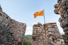 Catalan flag wavin. G over a ruined castle Royalty Free Stock Photos