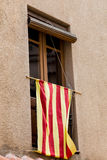 Catalan flag in window Stock Image