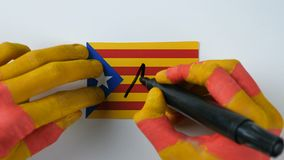 Catalan hands writes NO on the Catalan flag stock video footage