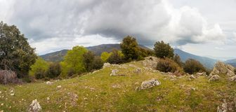 Catalan highlands panorama cloudscape. A panoramic view of the Catalan highlands under a threatening stormy cloudscape stock photos
