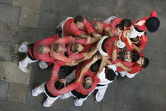 Catalan human castle. (castells or castillos humanos) team practicing in a gothic quarter side street of Barcelona prior to competing in La Merce Festival Stock Images