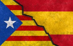 Catalan independence referendum in Spain flag concept. Catalonia Independence referendum from Spain political concept exit or break Spanish and Catalan flag stock photo