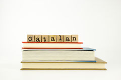 Catalan language word on wood stamps and books Stock Photos