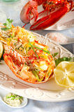 Catalan lobster. On dish with lemon and chive Royalty Free Stock Image