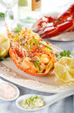 Catalan lobster. On dish with bottle of white wine Royalty Free Stock Photo