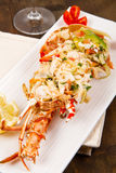Catalan lobster. On white dish on wooden table Stock Image