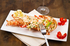 Catalan lobster. On white dish on wooden table Stock Photo