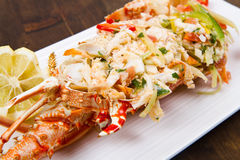 Catalan lobster. On white dish on wooden table Stock Photography