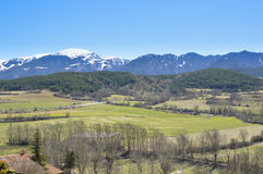 Catalan Pyrenees mountains and trees landscape, Puigcerdà, Cerdanya, Spain. Beautiful landscape of the snowy mountain of the Catalan Pyrenees, in the spring Royalty Free Stock Photography