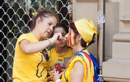 Catalan  women making Catalan Flag on face Royalty Free Stock Photography