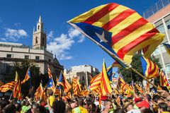 Catalans Waving Estelada Flags. During march for independence on September 11, 2017 in Barcelona, Spain Stock Images