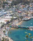 Catalina Island vacation resort, Avalon, California, aerial view of green pleasure pier, calm ocean bay view of colorful houses, b Royalty Free Stock Images