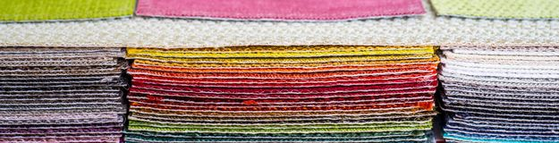Catalog of multicolored cloth from matting fabric texture background, silk fabric texture royalty free stock photos