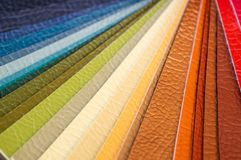 Catalog of multicolored imitation leather from matting fabric texture background, leatherette fabric texture stock photography