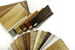 Catalog samples of wood colors on white background. Sample wood texture and Accessories. Small color sample boards. toned image Stock Image