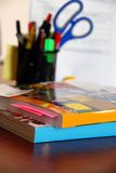Catalogs on office desk Stock Images