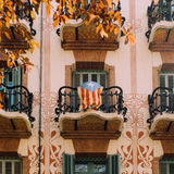 Catalonia. A Catalonian flag hangs from a balcony of an Art Nouveau apartment building in Barcelona Royalty Free Stock Image