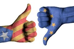 Catalonia and Europe flag on human male thumb up and down hands Stock Photography