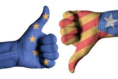 Catalonia and Europe flag on human male thumb up and down hands. Catalonia and Europe  flag on human male thumb up and down hands Royalty Free Stock Photography