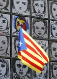 Catalonia flag waving next to Why wall art vertical. An estelada flag, Catalan separatist flag, waves next to the piece called Why by Carme Solé Vendrell in royalty free stock photography