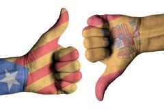 Catalonia on human male thumb up and down hands Royalty Free Stock Photography