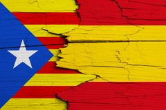 Catalonia independence movement versus Spain: symbolic for ongoing dispute on separation and autonomy. Flags of Catalan separatism and Spanish national flag Stock Photo