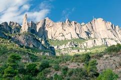 catalonia montserrat bergsky spain Arkivbilder