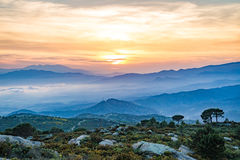 Catalonia mountains at sunset. Misty mountains at golden hour near Roses, Spain Royalty Free Stock Photography