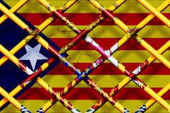 CATALONIA, SPAIN, 1 October 2017 - Spain forbids the referendum and secession in Catalonia. Digital Illustration of Catalonia Flag behind Spanish fence Royalty Free Stock Image