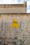 Spanish Catalonian yellow ribbon symbol for independance on the old stone wall of a cathedral stock photo