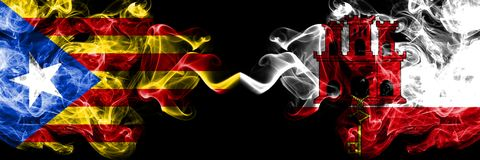 Catalonia vs Gibraltar smoke flags placed side by side. Thick colored silky smoke flags of Catalonia and Gibraltar stock photography