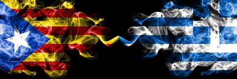 Catalonia vs Greece, Greek smoke flags placed side by side. Thick colored silky smoke flags of Catalonia and Greece, Greek stock images