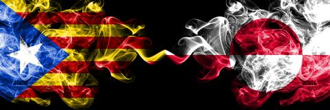 Catalonia vs Greenland smoke flags placed side by side. Thick colored silky smoke flags of Catalonia and Greenland stock photos