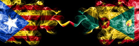 Catalonia vs Grenada smoke flags placed side by side. Thick colored silky smoke flags of Catalonia and Grenada royalty free stock photography