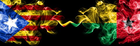 Catalonia vs Guinea Bissau smoke flags placed side by side. Thick colored silky smoke flags of Catalonia and Guinea Bissau stock photography