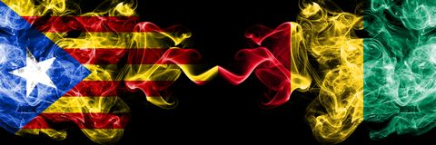 Catalonia vs Guinea, Guinean smoke flags placed side by side. Thick colored silky smoke flags of Catalonia and Guinea, Guinean stock photography