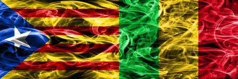 Catalonia vs Mali copy smoke flags placed side by side. Thick colored silky smoke flags of Catalan and Mali copy.  Royalty Free Illustration