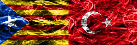 Catalonia vs Turkey copy smoke flags placed side by side. Thick colored silky smoke flags of Catalan and Turkey copy royalty free stock photography