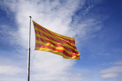 Catalonian flag. With blue sky and clouds Royalty Free Stock Photo