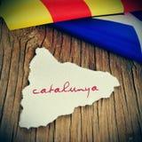 Catalunya catalonia som är skriftlig i catalan i ett stycke av papper i t Arkivbilder