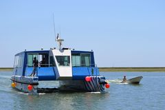 Catamaran. A modern catamaran to visit the lagoon. The shot was taken in The Ria Formosa lagoon, located in Algarve, Portugal. The Ria Formosa is a Natural Park stock photo